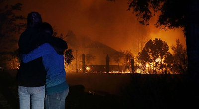 Thousands Flee As Wildfires Ravage California; 15 Killed